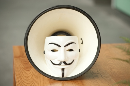 guy fawkes mask: Guy Fawkes mask in megaphone on table  Editorial
