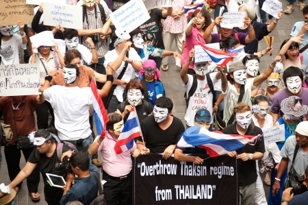 fawkes: Bangkok,Thailand-June 2,2013   About 700 demonstrators from the anti-government V for Thailand group wear Guy Fawkes masks to protest against the government at the Central World shopping complex on June 2,2013 in Bangkok,Thailand