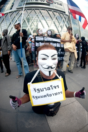 demonstrators: Bangkok,Thailand-June 9,2013   Unidentified demonstrators from the anti- government V for Thailand group wear Guy Fawkes masks to protest against the government outside at the shopping mall on June 9,2013 in Bangkok,Thailand