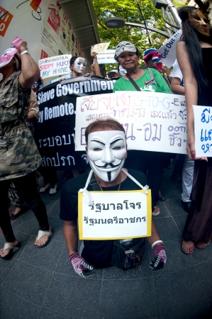 Bangkok,Thailand-June 9,2013   Unidentified demonstrators from the anti- government V for Thailand group wear Guy Fawkes masks to protest against the government outside at the shopping mall on June 9,2013 in Bangkok,Thailand