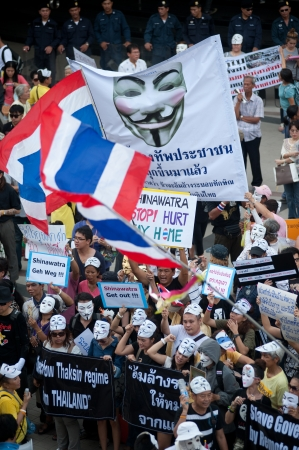 guy fawkes mask: Bangkok,Thailand-June 9,2013   Unidentified demonstrators from the anti- government V for Thailand group wear Guy Fawkes masks to protest against the government outside at the Bangkok Art and Culture Organized on June 9,2013 in Bangkok,Thailand  Editorial
