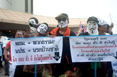 demonstrators: Bangkok,Thailand-June 9,2013   Unidentified demonstrators from the anti- government V for Thailand group wear Guy Fawkes masks to protest against the government outside at the Bangkok Art and Culture Organized on June 9,2013 in Bangkok,Thailand  Editorial