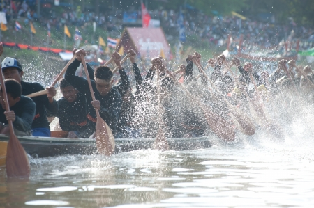 procession: Chumphon ,Thailand-November 3,2012   Unidentified rowers enjoy  in Climbing Bows toward Snatching a Flag native Thai long boats compete during King s cup Native Long Boat Race Championship on November  3, 2012 in Chumphon Province ,Southern of Thailand  Editorial