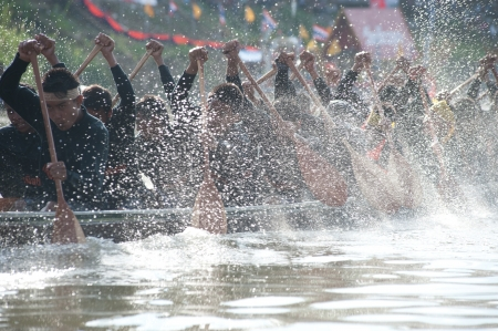 contend: Chumphon ,Thailand-November 3,2012   Unidentified rowers enjoy  in Climbing Bows toward Snatching a Flag native Thai long boats compete during King s cup Native Long Boat Race Championship on November  3, 2012 in Chumphon Province ,Southern of Thailand  Editorial