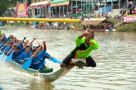 procession: Chumphon ,Thailand-November 4,2012   Unidentified rowers enjoy  in Climbing Bows toward Snatching a Flag native Thai long boats compete during King s cup Native Long Boat Race Championship on November  4, 2012 in Chumphon Province ,Southern of Thailand