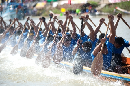 Chumphon ,Thailand-November 3,2012   Unidentified rowers enjoy  in Climbing Bows toward Snatching a Flag native Thai long boats compete during King s cup Native Long Boat Race Championship on November  3, 2012 in Chumphon Province ,Southern of Thailand  Editorial