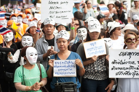 demonstrators: Bangkok,Thailand-June 16,2013   Unidentified demonstrators from the anti- government V for Thailand group wear Guy Fawkes masks to protest against the government outside at the shopping mall on June 16,2013 in Bangkok,Thailand