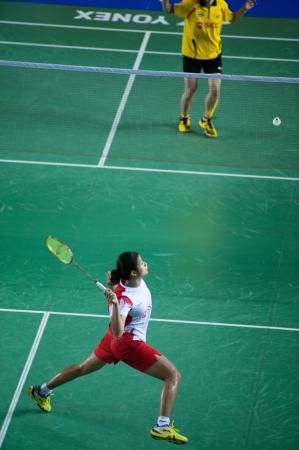 footwork: BANGKOK,THAILAND – AUGUST 31   Porntip Buranaprasert badminton player in action during SCG All Thailand Badminton Championships at Nimibutr National Indoor Stadium on August 31,2013 in Bangkok,Thailand