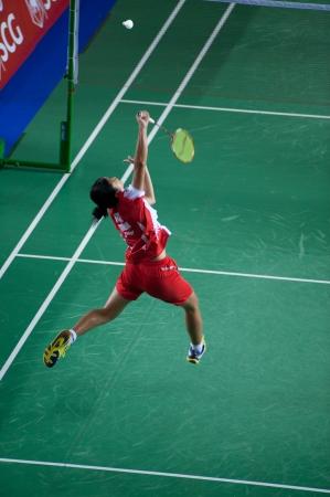 unsatisfactory: BANGKOK,THAILAND � AUGUST 31   Porntip Buranaprasert badminton player in action during SCG All Thailand Badminton Championships at Nimibutr National Indoor Stadium on August 31,2013 in Bangkok,Thailand