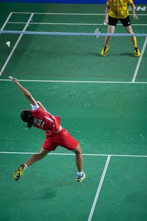 racket stadium: BANGKOK,THAILAND : AUGUST 31   Porntip Buranaprasert badminton player in action during SCG All Thailand Badminton Championships at Nimibutr National Indoor Stadium on August 31,2013 in Bangkok,Thailand