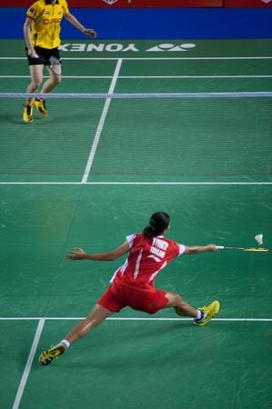 racket stadium: BANGKOK,THAILAND – AUGUST 31   Porntip Buranaprasert badminton player in action during SCG All Thailand Badminton Championships at Nimibutr National Indoor Stadium on August 31,2013 in Bangkok,Thailand