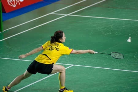 contend: BANGKOK,THAILAND � AUGUST 31   Nitchaon Jindaphon badminton player in action during SCG All Thailand Badminton Championships at Nimibutr National Indoor Stadium on August 31,2013 in Bangkok,Thailand  Editorial