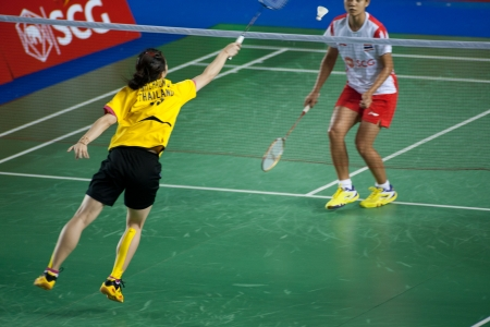 emulate: BANGKOK,THAILAND � AUGUST 31   Nitchaon Jindaphon badminton player in action during SCG All Thailand Badminton Championships at Nimibutr National Indoor Stadium on August 31,2013 in Bangkok,Thailand  Editorial