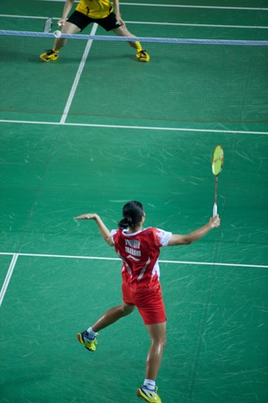 contend: BANGKOK,THAILAND � AUGUST 31   Porntip Buranaprasert badminton player in action during SCG All Thailand Badminton Championships at Nimibutr National Indoor Stadium on August 31,2013 in Bangkok,Thailand