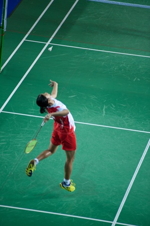 emulate: BANGKOK,THAILAND � AUGUST 31   Porntip Buranaprasert badminton player in action during SCG All Thailand Badminton Championships at Nimibutr National Indoor Stadium on August 31,2013 in Bangkok,Thailand