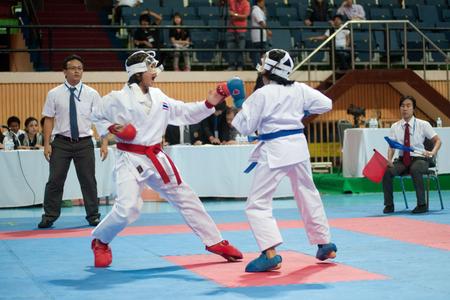 inter: BANGKOK,THAILAND - SEPTEMBER 9  Female fighter between participants of Thailand Open Karate-Do Championship 2013 on Nimibutr National Indoor Stadium, September 9, 2013, Bangkok,Thailand