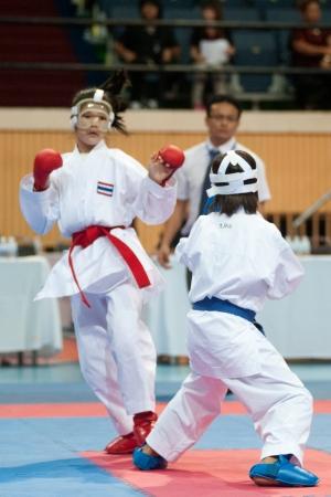 BANGKOK,THAILAND - SEPTEMBER 9  Female fighter between participants of Thailand Open Karate-Do Championship 2013 on Nimibutr National Indoor Stadium, September 9, 2013, Bangkok,Thailand