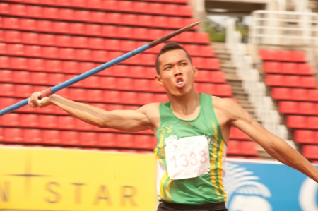 javelin throw: PHATUMTANI,THAILAND � SEPTEMBER,6   Khachen Bunhuan player  action of  Javelin Throw in Thailand Open Track and Field Championships 2013 at Thammashat University stadium on September 6,2013 in Phatumtani city ,Middle of Thailand  Editorial