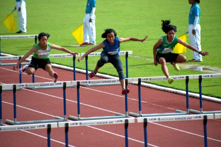 PHATUMTANI,THAILAND � SEPTEMBER,6  Groups of player action of 100 m Hurdles in Thailand Open Athletic Championships 2013 at Thammashat University stadium on September 6,2013 in Phatumtani city ,Middle of Thailand