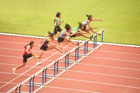 achievment: PHATUMTANI,THAILAND – SEPTEMBER,6  Groups of player action of 100 m Hurdles in Thailand Open Athletic Championships 2013 at Thammashat University stadium on September 6,2013 in Phatumtani city ,Middle of Thailand