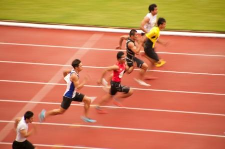 PHATUMTANI,THAILAND � SEPTEMBER,6  Groups of player action of 100 m in Thailand Open Athletic Championships 2013 at Thammashat University stadium on September 6,2013 in Phatumtani city ,Middle of Thailand
