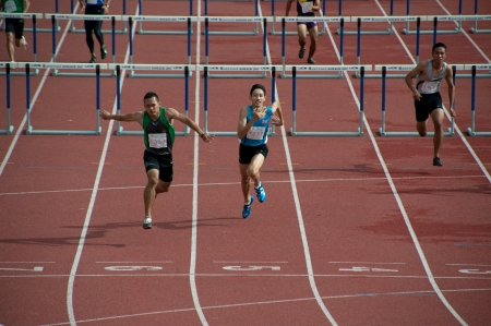achievment: PHATUMTANI,THAILAND � SEPTEMBER,6  Groups of player action of 100 m Hurdles in Thailand Open Athletic Championships 2013 at Thammashat University stadium on September 6,2013 in Phatumtani city ,Middle of Thailand