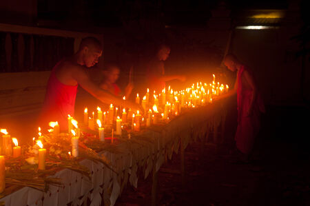 Candles in boat during Loykratong festival in Laos