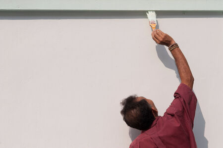 Male painting the wall  photo