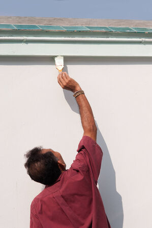 homeownership: Male painting the wall  Stock Photo