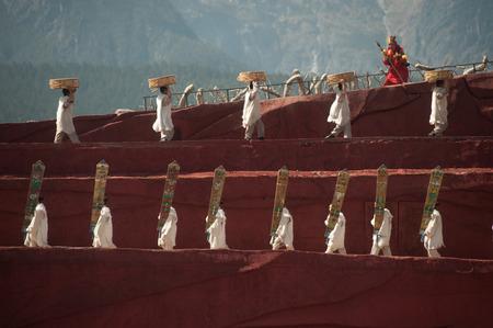 finery: LIJIANG,CHINA-MARCH 16   Actors participate Impression Lijiang live performance on March 16,2014,at Yunnan Lijiang Ganhaizi Blue Moon theater in Lijiang, Yunnan Province at Southwestern of China