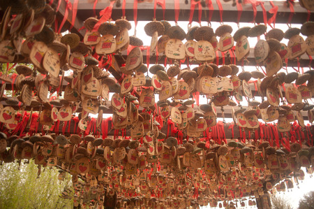 dogma:  Wood of love hanging on pole in Shuhe ancient town
