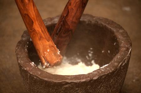 pounding:  Pounding rice in a mortar