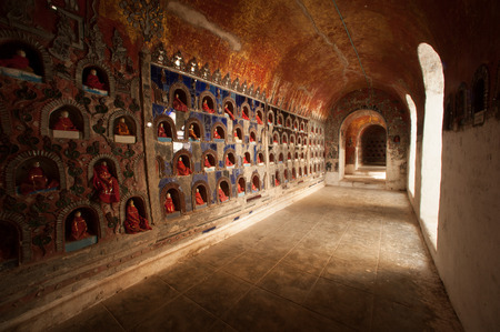 The Temple contains hundreds of Buddhas in alcoves on the wall, a spectacular site in pagoda of Nyan Shwe Kgua temple near Inle lake in Nyaungshwe,Myanmar.