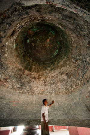 biggest: Man under Mingun is the largest Bell in the World located Sagaing Region,Myanmar. Stock Photo