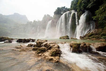 Ban Gioc Waterfall on the Quy Xuan River is located in Cao Bang Province, nears the Sino-Vietnamese border. The waterfall falls thirty meters. Located  in  Northern of Vietnam. photo