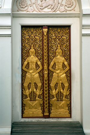 blacked: Art blacked Wood doors are beautiful, Which is the symbol of the Guardian site in Wat Chaiyo Worawihan temple , Angthong Province ,Central of Thailand.