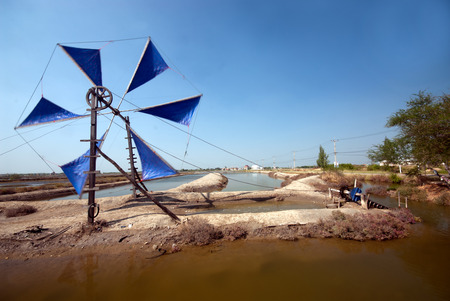 Ancient wind mill use for move the sea water into the salt field in Thailand. photo