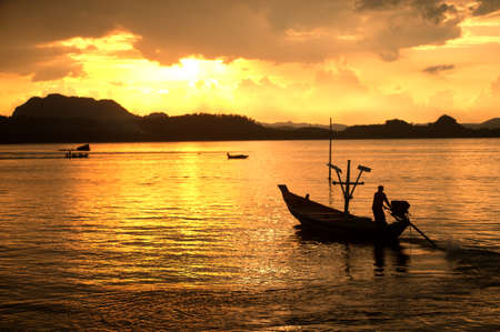 long tailed boat: Traditional fisherman long tailed boat in Koh Phitak island, Thailand at sunset.