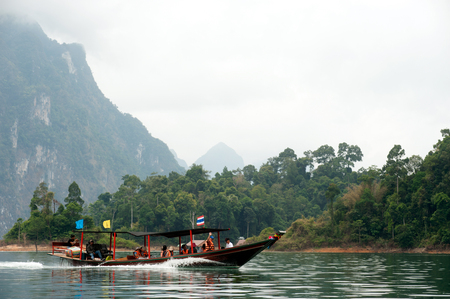 thai dam: Traditional tourist boat on Cheow Larn lake in Khao Sok National park, Thailand.