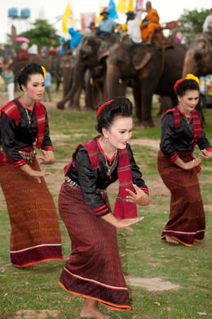 local festivals: Group of traditional dancing in Ordination parade on elephants back Festival. Editorial