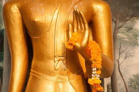 buddha hand: Garland on Buddha hand.