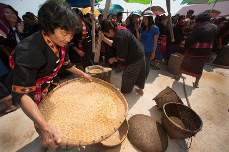 minority: Unidentified Phutai minority competitive winnowing in The 2nd International Phutai Festival. Editorial