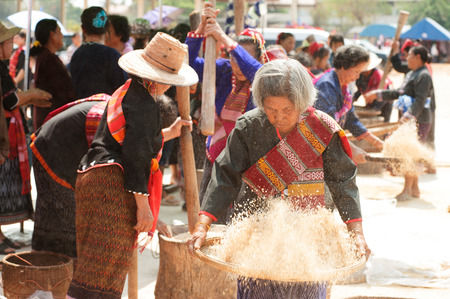 winnowing: Unidentified Phutai minority competitive winnowing in The 2nd International Phutai Festival. Editorial