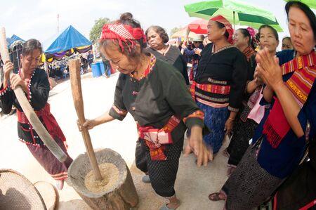 pounding: Unidentified Phutai minority competitive pounding in The 2nd International Phutai Festival. Editorial