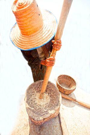 pounder: Unidentified Phutai minority competitive pounding in The 2nd International Phutai Festival. Editorial