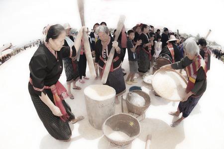 minority: Unidentified Phutai minority competitive pounding in The 2nd International Phutai Festival. Editorial