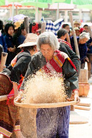 Unidentified Phutai minority competitive winnowing in The 2nd International Phutai Festival. Editorial