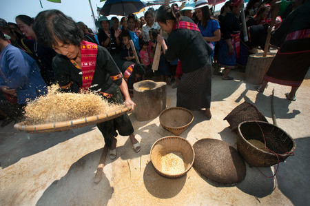 winnowing: Unidentified Phutai minority competitive winnowing in The 2nd International Phutai Festival. Editorial