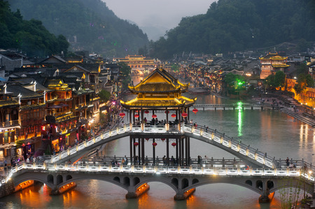 Twilight of Fenghuang ancient city  Phoenix town . Standard-Bild