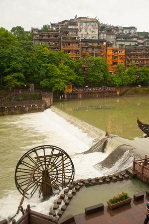 waterwheel: Waterwheel in Fenghuang ancient city. Stock Photo